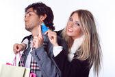 Joyful girl takes boyfriend credit card — Stock Photo