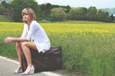 Beautiful girl on old suitcase — Stock Photo