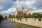 Notre Dame of Paris with a cloudy blue sky — Stock Photo
