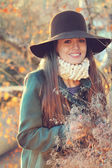 Smiling beautiful girl in sunset light — Stock Photo