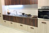 Modern and stylish brown kitchen — Stock Photo