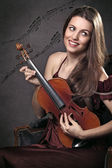 Funny and beautiful violin musician with music notes — Stock Photo