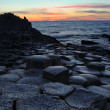 Stock Photo: Giant's Causeway in Antrim county at sunset