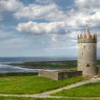Doonagore castle with cloudy sky — Stock Photo