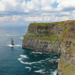Cliffs of Moher with cloudy seascape — Stock Photo