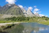 Reflection of an alpine landscape — Stock Photo