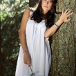 Beautiful girl posing in evergreen forest — Stock Photo