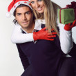 Smiling and funny Christmas couple — Stock Photo #32276237