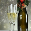 Christmas glasses and a bottle of champagne — Stock Photo