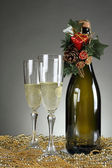 Christmas glasses on a golden decoration — Stock Photo