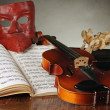 Venetian mask with old violin — Stock Photo