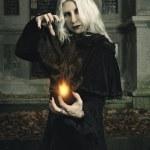 Dark mage manipulates fire — Stock Photo