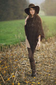 Autumn portrait of a girl posing in a field — Stock Photo