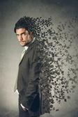 Artistic erosion effect on businessman — Stock Photo