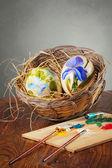 Decorative eggs and paintbrushes — Photo