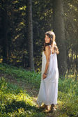Beautiful  and happy young woman in the forest  — Stock Photo