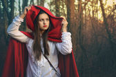 Dark portrait of Little red riding hood — Stock Photo