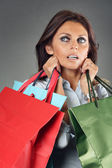 Shopping woman carrying bags — Stock Photo
