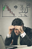 Worried businessman losing on financial markets — 图库照片