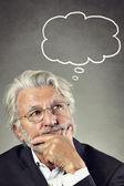 Portrait of a senior man thinking — Stock Photo