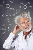 Researcher with chemistry formulas — Stock Photo