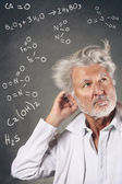 Scientist with chemistry formulas — Stock Photo