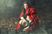 Little red riding hood waiting the prey — Stock Photo