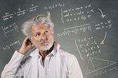 Scientist with mathematics formulas — Stock Photo