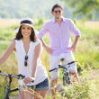 Smiling young couple with bicycles — Stock Photo #47756797