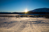 Beautiful winter picture with snowmobile trails — Stock Photo