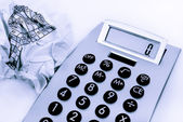 Calculator and a crumpled paper on the side — Stock Photo
