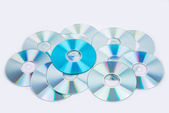 One blue and several normal CD DVD discs — 图库照片