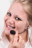 Happy, smiling professional woman with headset — Stock Photo