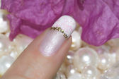 Nails with a French manicure with a gold stripe — Stock Photo