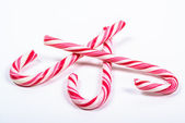 Three twisted red and white candy canes — Stockfoto