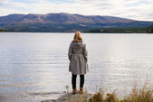 Alone thinking woman standing on a stone — Stock Photo