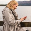 Stock Photo: Womwho is focused on her smartphone
