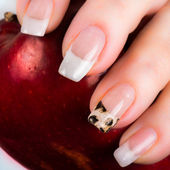 Nails with a French manicure and foil on one of the nail tips — Stock Photo