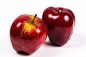 Two red delicious apple on a white background — Foto Stock
