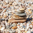 Stack of pebble stones on the beach — Stock Photo #29938741
