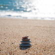 Stack of pebble stones on the beach — Stock Photo