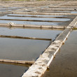 Evaporation ponds of salt farm, Portugal — Stock Photo #39114925
