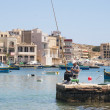 Fisherman fishing in Marsaskala, Malta — Stock Photo #48488605