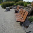 Benches and stones in park - Stock Photo