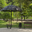 Umbrella of iron and bench - Stock Photo