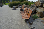 Benches and stones in park — Stockfoto