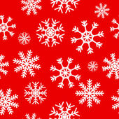 White snowflakes on red background — Stock Vector