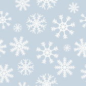 White snowflakes on gray background — Stock Vector