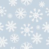 White snowflakes on gray background — Stock Vector