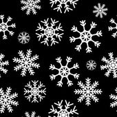 White snowflakes on black background — Stock Vector